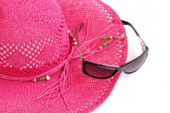 Beach hat and glasses on white. Holiday theme.